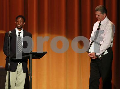 "Mark Martin/Freelance John Tyler High School Student Clifton Henry Jr (left), speaks about his shining star Azmon Walker (right), Monday night during the Tyler ISD Foundation ""A Night of Shining Stars"" program, at Caldwell Auditorium."