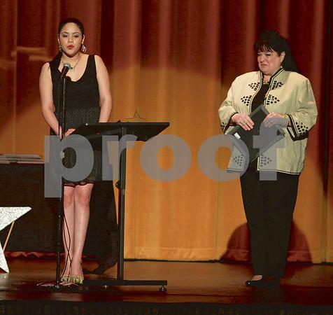 "Mark Martin/Freelance John Tyler High School Student Cristal Galindez (left), speaks about her shining star Sandra Taylor (right), Monday night during the Tyler ISD Foundation ""A Night of Shining Stars"" program, at Caldwell Auditorium."