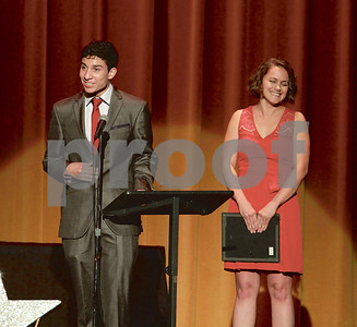 """Mark Martin/Freelance Robert E. Lee High School Student Christian Rivera (left), speaks about his shining star Allison Rogers (right), Monday night during the Tyler ISD Foundation """"A Night of Shining Stars"""" program, at Caldwell Auditorium."""