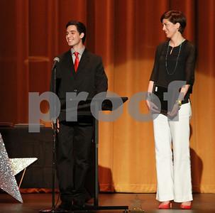 "Mark Martin/Freelance Robert E. Lee High School Student Rafael Guzman (left), speaks about his shining star Melinda Tefteller (right), Monday night during the Tyler ISD Foundation ""A Night of Shining Stars"" program, at Caldwell Auditorium."