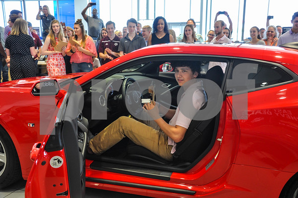 Dylan Tucker, 17, one of forty Peltier Enterprises Annual Teachers' Scholarship recipients, is all smiles after being awarded a new 2018 Chevrolet Camaro as part of the Scholarship. 40 local students received the Annual Scholarship on Saturday, May 19. (Jessica T. Payne/Tyler Paper)