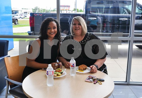 DeJa Hamilton (left), a recipient of the Annual Teachers' Scholarship, and her mom Tonya Morris (right) enjoy lunch at Petlier Chevrolet. Local students were awarded Annual Teachers' Scholarships from Peltier Enterprises on Saturday, May 19. 40 students received the scholarship with one being awarded a new 2018 Chevrolet Camaro. (Jessica T. Payne/Tyler Paper)