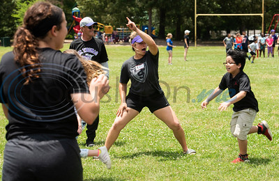 St. Thomas (Minn.) softball team player Chase Shortly points toward home plate as Andy Woods Elementary School fourth grader Niko Martinez runs during their game of kickball together at Pollard Park on Wednesday May 22, 2019. The St. Thomas team is in Tyler for the NCAA World Series which is being held at UT-Tyler starting on Thursday.  (Sarah A. Miller/Tyler Morning Telegraph)