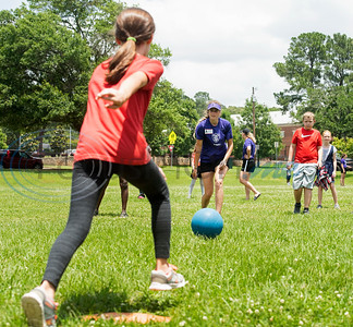 St. Thomas (Minn.) softball team player Jenna Beeso pitches the ball to Andy Woods Elementary School fourth grader Madison Devissoher during their game of kickball together at Pollard Park on Wednesday May 22, 2019. The St. Thomas team is in Tyler for the NCAA World Series which is being held at UT-Tyler starting on Thursday.  (Sarah A. Miller/Tyler Morning Telegraph)