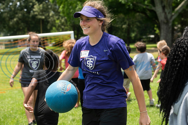 St. Thomas (Minn.) softball team player Jenna Beeso plays kickball with Andy Woods Elementary School fourth graders  at Pollard Park on Wednesday May 22, 2019. The St. Thomas team is in Tyler for the NCAA World Series which is being held at UT-Tyler starting on Thursday.  (Sarah A. Miller/Tyler Morning Telegraph)