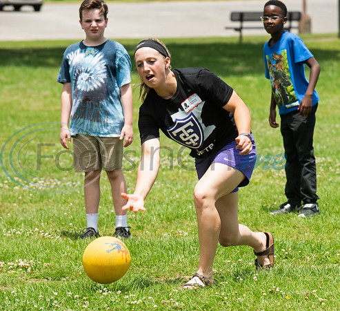 St. Thomas (Minn.) softball team player Elise Barnes plays kickball with Andy Woods Elementary School fourth graders  at Pollard Park on Wednesday May 22, 2019. The St. Thomas team is in Tyler for the NCAA World Series which is being held at UT-Tyler starting on Thursday.  (Sarah A. Miller/Tyler Morning Telegraph)