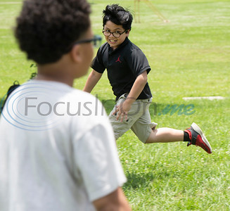 Andy Woods Elementary School fourth grader Niko Martinez runs during their game of kickball together with the St. Thomas (Minn.) softball team at Pollard Park on Wednesday May 22, 2019. The St. Thomas team is in Tyler for the NCAA World Series which is being held at UT-Tyler starting on Thursday.  (Sarah A. Miller/Tyler Morning Telegraph)