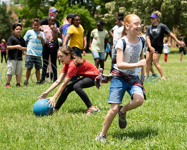 Andy Woods Elementary School fourth graders play kickball with help from the St. Thomas (Minn.) softball team at Pollard Park on Wednesday May 22, 2019. The St. Thomas team is in Tyler for the NCAA World Series which is being held at UT-Tyler starting on Thursday.  (Sarah A. Miller/Tyler Morning Telegraph)