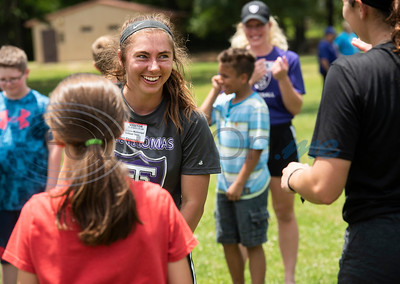 St. Thomas (Minn.) softball team player Kristin McGonigal plays kickball with Andy Woods Elementary School fourth graders  at Pollard Park on Wednesday May 22, 2019. The St. Thomas team is in Tyler for the NCAA World Series which is being held at UT-Tyler starting on Thursday.  (Sarah A. Miller/Tyler Morning Telegraph)