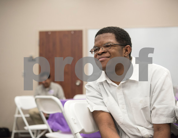 Project Search intern D'Vonte Valentine watches a video about the Project Search internships during a graduation ceremony on Friday May 25, 2018 at the Wisenbaker Conference Center at Christus Mother Frances Hospital in Tyler. Project Search is a partnership with Christus Trinity Mother Frances Health System, Tyler ISD, the Texas Workforce Solutions Vocational Rehabilitation Services, Winning Edge Employment Services, and the Andrews Center Behavioral Healthcare System that provides life skills and job training through internships for Tyler ISD students with disabilities.  (Sarah A. Miller/Tyler Morning Telegraph)