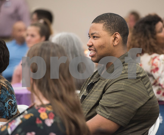 Project Search intern Keith London smiles as he watches a video about the Project Search internships during a graduation ceremony on Friday May 25, 2018 at the Wisenbaker Conference Center at Christus Mother Frances Hospital in Tyler. Project Search is a partnership with Christus Trinity Mother Frances Health System, Tyler ISD, the Texas Workforce Solutions Vocational Rehabilitation Services, Winning Edge Employment Services, and the Andrews Center Behavioral Healthcare System that provides life skills and job training through internships for Tyler ISD students with disabilities.  (Sarah A. Miller/Tyler Morning Telegraph)