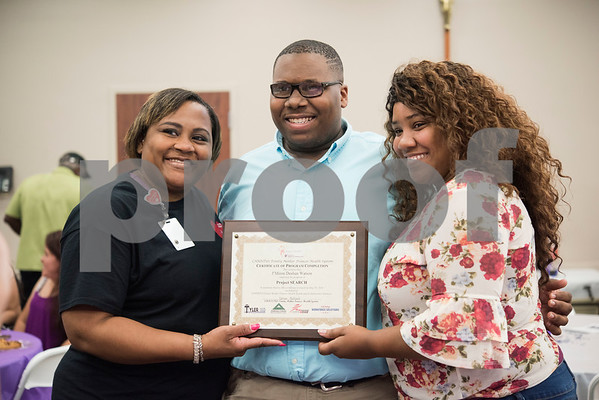 J'Miron Watson, a Project Search intern, takes a photo with his mother Nachell Ivory, left, and step-mother Crystal Watson, right, during a graduation ceremony on Friday May 25, 2018 at the Wisenbaker Conference Center at Christus Mother Frances Hospital in Tyler. Project Search is a partnership with Christus Trinity Mother Frances Health System, Tyler ISD, the Texas Workforce Solutions Vocational Rehabilitation Services, Winning Edge Employment Services, and the Andrews Center Behavioral Healthcare System that provides life skills and job training through internships for Tyler ISD students with disabilities.  (Sarah A. Miller/Tyler Morning Telegraph)