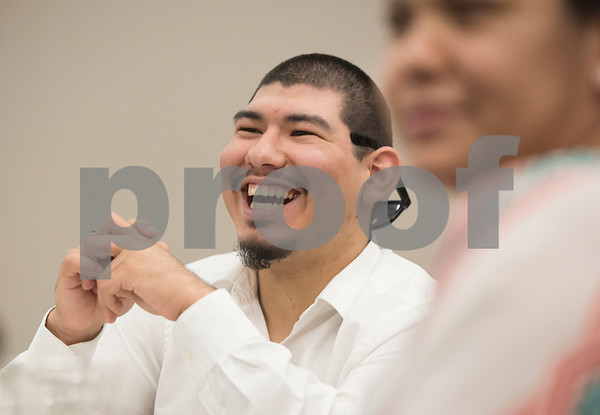 Project Search intern Javier Vergara laughs as he watches a video about the Project Search internships during a graduation ceremony on Friday May 25, 2018 at the Wisenbaker Conference Center at Christus Mother Frances Hospital in Tyler. Project Search is a partnership with Christus Trinity Mother Frances Health System, Tyler ISD, the Texas Workforce Solutions Vocational Rehabilitation Services, Winning Edge Employment Services, and the Andrews Center Behavioral Healthcare System that provides life skills and job training through internships for Tyler ISD students with disabilities.  (Sarah A. Miller/Tyler Morning Telegraph)