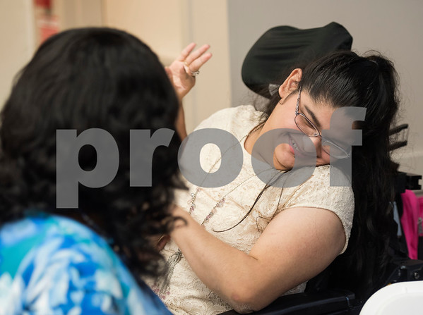 Laura Tapia-Guerrero, a Project Search intern, smiles after she receives her certificate of completion from the program during a graduation ceremony on Friday May 25, 2018 at the Wisenbaker Conference Center at Christus Mother Frances Hospital in Tyler. Project Search is a partnership with Christus Trinity Mother Frances Health System, Tyler ISD, the Texas Workforce Solutions Vocational Rehabilitation Services, Winning Edge Employment Services, and the Andrews Center Behavioral Healthcare System that provides life skills and job training through internships for Tyler ISD students with disabilities.  (Sarah A. Miller/Tyler Morning Telegraph)
