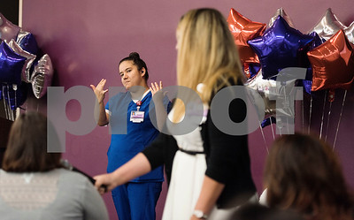 Project Search graduate Natalie Flores uses sign language as she talks about her internship experience with Christus Trinity Mother Frances Health System during the Project Search graduation ceremony on Friday May 25, 2018 at the Wisenbaker Conference Center at Christus Mother Frances Hospital in Tyler. Flores started a job with the surgical processing department with Christus Mother Frances Hospital after her internship. Project Search is a partnership with Tyler ISD, the Texas Workforce Solutions Vocational Rehabilitation Services, Winning Edge Employment Services, and the Andrews Center Behavioral Healthcare System that provides life skills and job training through internships for Tyler ISD students with disabilities.  (Sarah A. Miller/Tyler Morning Telegraph)