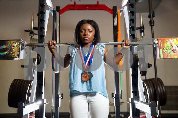 Venisha Harmon poses for a portrait in the weight room at Robert E. Lee High School in Tyler, Texas, on Friday, May 26, 2017. Harmon is a graduating IB senior near the top 10 percent of her class who was the first female powerlifter at the school. She will be attending The University of Texas at Dallas and hopes to continue powerlifting in college. (Chelsea Purgahn/Tyler Morning Telegraph)