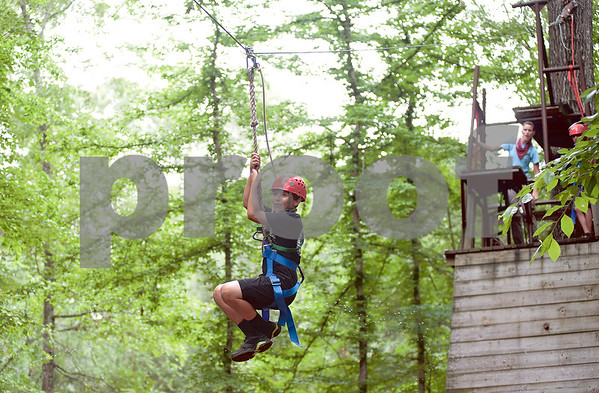 photo by Sarah A. Miller/Tyler Morning Telegraph  Seventh grader Carson Rudd, 13, goes down the zip line at Chapel Hill Middle School's Reward Day for UIL Academic students at Camp Tyler Outdoor School Wednesday. This was the third year for the camp which provides team building activities and games for sixth, seventh and eighth graders.
