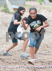 photo by Sarah A. Miller/Tyler Morning Telegraph  Seventh graders Aparna Chapagain, 13, and Shaeeka Thapa, 12, play a game called capture the flag at Chapel Hill Middle School's Reward Day for UIL Academic students at Camp Tyler Outdoor School Wednesday. This was the third year for the camp which provides team building activities and games for sixth, seventh and eighth graders.