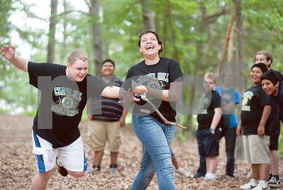 photo by Sarah A. Miller/Tyler Morning Telegraph  Eighth grader Chase Miller, 14, and seventh grader Lidia Cabrera, 12, play a game called capture the flag at Chapel Hill Middle School's Reward Day for UIL Academic students at Camp Tyler Outdoor School Wednesday. This was the third year for the camp which provides team building activities and games for sixth, seventh and eighth graders.