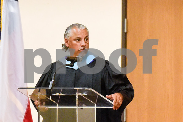 Tyler ISD assistant superintendent of schools Rawly Sanchez speaks during Rise Academy's graduation at St. Louis Baptist Church in Tyler, Texas, on Thursday, May 31, 2018. Hundreds of family members and friends attended to see the 55 students graduate. (Chelsea Purgahn/Tyler Morning Telegraph)