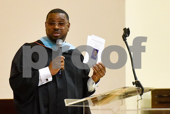 Principal Dexter Q. Floyd speaks during Rise Academy's graduation at St. Louis Baptist Church in Tyler, Texas, on Thursday, May 31, 2018. Hundreds of family members and friends attended to see the 55 students graduate. (Chelsea Purgahn/Tyler Morning Telegraph)