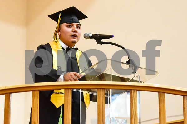 Graduate Adrian Gonzalez speaks during Rise Academy's graduation at St. Louis Baptist Church in Tyler, Texas, on Thursday, May 31, 2018. Hundreds of family members and friends attended to see the 55 students graduate. (Chelsea Purgahn/Tyler Morning Telegraph)