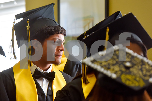Emmanual Sotelo stands with other students during Rise Academy's graduation at St. Louis Baptist Church in Tyler, Texas, on Thursday, May 31, 2018. Hundreds of family members and friends attended to see the 55 students graduate. (Chelsea Purgahn/Tyler Morning Telegraph)