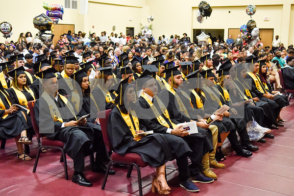 Graduates listen during Rise Academy's graduation at St. Louis Baptist Church in Tyler, Texas, on Thursday, May 31, 2018. Hundreds of family members and friends attended to see the 55 students graduate. (Chelsea Purgahn/Tyler Morning Telegraph)
