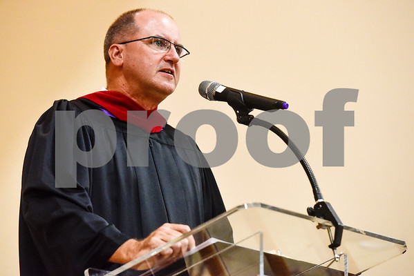 Tyler ISD board president Fritz Hager Jr. speaks during Rise Academy's graduation at St. Louis Baptist Church in Tyler, Texas, on Thursday, May 31, 2018. Hundreds of family members and friends attended to see the 55 students graduate. (Chelsea Purgahn/Tyler Morning Telegraph)