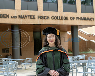 Ngoc Nguyen, valedictorian of the UT Tyler pharmacy graduating class, stands in front of the Ben and Maytee Fisch College of Pharmacy building on the campus of UT Tyler. (Rick Flack/Freelance)
