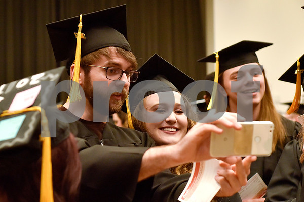 Chemistry graduates David Allen and Payton Hightower take a selfie before The University of Texas at Tyler's spring commencement ceremony for the College of Arts and Sciences in Tyler, Texas, on Friday, May 5, 2017. Hundreds of students received their undergraduate and graduate degrees during the ceremony. (Chelsea Purgahn/Tyler Morning Telegraph)