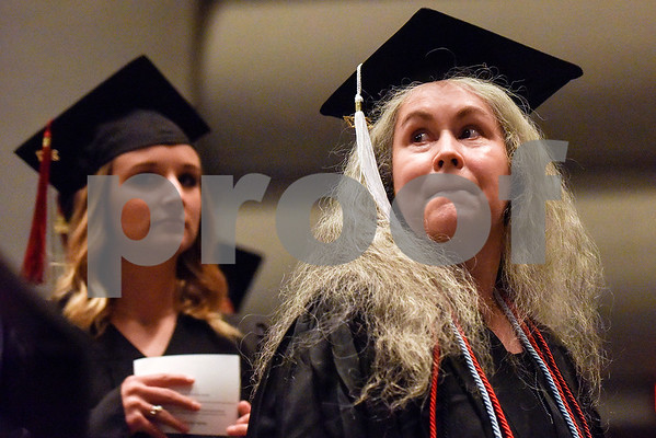 A graduate looks over her shoulder to the crowd during The University of Texas at Tyler's spring commencement ceremony for the College of Arts and Sciences in Tyler, Texas, on Friday, May 5, 2017. Hundreds of students received their undergraduate and graduate degrees during the ceremony. (Chelsea Purgahn/Tyler Morning Telegraph)