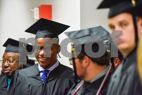 Political Science graduate Rasidi Ifafore smiles before The University of Texas at Tyler's spring commencement ceremony for the College of Arts and Sciences in Tyler, Texas, on Friday, May 5, 2017. Hundreds of students received their undergraduate and graduate degrees during the ceremony. (Chelsea Purgahn/Tyler Morning Telegraph)