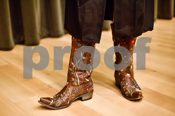 Fine Arts graduate Alayna Goldsmith wears cowboy boots with her graduation gown during The University of Texas at Tyler's spring commencement ceremony for the College of Arts and Sciences in Tyler, Texas, on Friday, May 5, 2017. Hundreds of students received their undergraduate and graduate degrees during the ceremony. (Chelsea Purgahn/Tyler Morning Telegraph)
