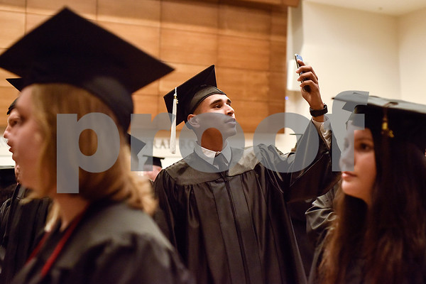 Spanish graduate Chris Rios takes a selfie before The University of Texas at Tyler's spring commencement ceremony for the College of Arts and Sciences in Tyler, Texas, on Friday, May 5, 2017. Hundreds of students received their undergraduate and graduate degrees during the ceremony. (Chelsea Purgahn/Tyler Morning Telegraph)