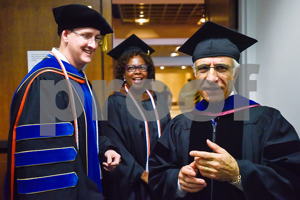 Dr. Stephen Graves, Dr. Vanessa Joyner and Dr. Ali Azghani chat before The University of Texas at Tyler's spring commencement ceremony for the College of Arts and Sciences in Tyler, Texas, on Friday, May 5, 2017. Hundreds of students received their undergraduate and graduate degrees during the ceremony. (Chelsea Purgahn/Tyler Morning Telegraph)
