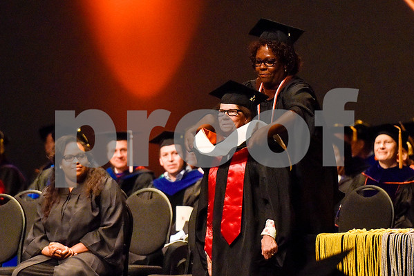 A masters graduate receives a hood from Dr. Vanessa Joyner during The University of Texas at Tyler's spring commencement ceremony for the College of Arts and Sciences in Tyler, Texas, on Friday, May 5, 2017. Hundreds of students received their undergraduate and graduate degrees during the ceremony. (Chelsea Purgahn/Tyler Morning Telegraph)