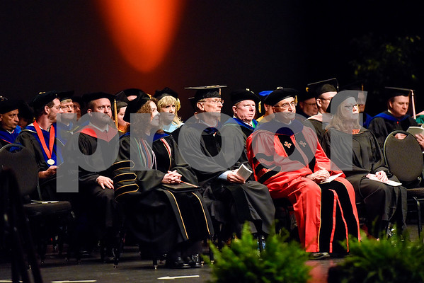 Faculty sit and listen during The University of Texas at Tyler's spring commencement ceremony for the College of Arts and Sciences in Tyler, Texas, on Friday, May 5, 2017. Hundreds of students received their undergraduate and graduate degrees during the ceremony. (Chelsea Purgahn/Tyler Morning Telegraph)