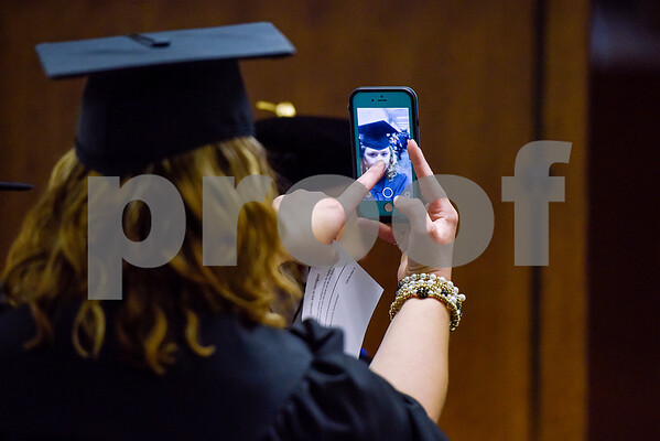 Communications graduate Jennifer Hannigan focuses her cell phone camera before The University of Texas at Tyler's spring commencement ceremony for the College of Arts and Sciences in Tyler, Texas, on Friday, May 5, 2017. Hundreds of students received their undergraduate and graduate degrees during the ceremony. (Chelsea Purgahn/Tyler Morning Telegraph)