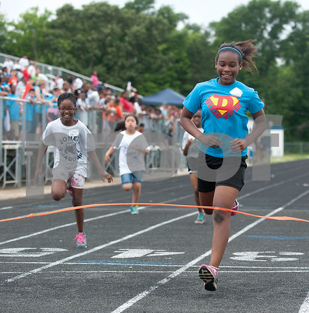Dixie Elementary School student Shania Miller, 10, crosses the finish line during the 50 yard dash during the fourth grade field day held at the John Tyler High School track Thursday May 7, 2015.   (photo by Sarah A. Miller/Tyler Morning Telegraph)