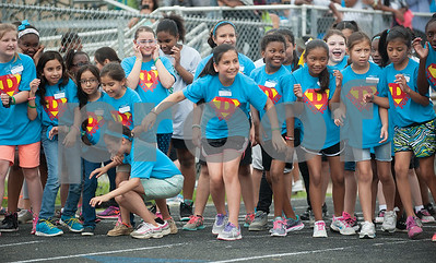 Dixie Elementary School students brace themselves for the sound of the gun to start their fun run race during the fourth grade field day held at the John Tyler High School track Thursday May 7, 2015.   (photo by Sarah A. Miller/Tyler Morning Telegraph)