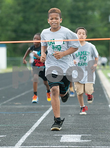 Ramey Elementary School student Eric Lester comes in first place during a fun run race at the fourth grade field day held at the John Tyler High School track Thursday May 7, 2015.   (photo by Sarah A. Miller/Tyler Morning Telegraph)
