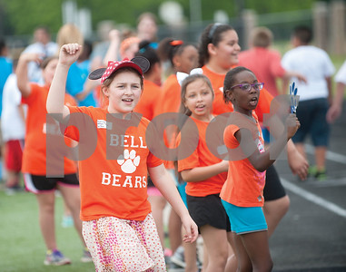 Bell Elementary School student Savannah Lampin cheers on her teammates during a fun run race at the fourth grade field day held at the John Tyler High School track Thursday May 7, 2015.   (photo by Sarah A. Miller/Tyler Morning Telegraph)