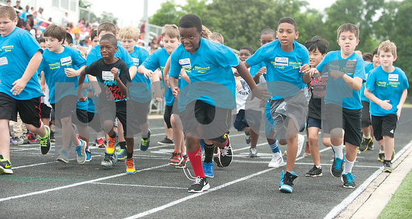 Jack Elementary School students take off from the starting line during a fun run race at the fourth grade field day held at the John Tyler High School track Thursday May 7, 2015.   (photo by Sarah A. Miller/Tyler Morning Telegraph)