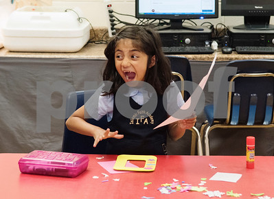 First grader Soha Choudhry makes a picture frame for her mom for Mother's Day during class at Islamic Faith Academy in Tyler Tuesday May 9, 2017. Mother's Day in Sunday May 14.   (Sarah A. Miller/Tyler Morning Telegraph)