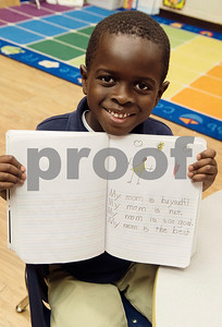 Kindergartener Abdul Malik Cham, 5, shows off a page and drawing in his notebook that he made about his mom during class at Islamic Faith Academy in Tyler Tuesday May 9, 2017. Mother's Day in Sunday May 14.   (Sarah A. Miller/Tyler Morning Telegraph)