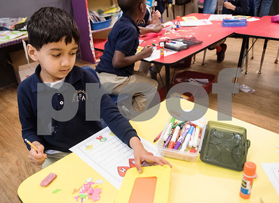 First grader Aariz Shaikh, 6, makes a picture frame for his mom for Mother's Day during class at Islamic Faith Academy in Tyler Tuesday May 9, 2017. Mother's Day in Sunday May 14.   (Sarah A. Miller/Tyler Morning Telegraph)