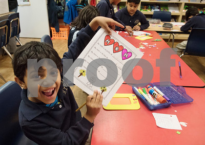 First grader Zain Nawab answers questions about his mom for Mother's Day during class at Islamic Faith Academy in Tyler Tuesday May 9, 2017. Mother's Day in Sunday May 14.   (Sarah A. Miller/Tyler Morning Telegraph)