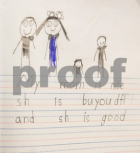 Kindergartener Myriam Ismail, 6, drew this picture of her family for her mother for Mother's Day during class at Islamic Faith Academy in Tyler Tuesday May 9, 2017. Mother's Day in Sunday May 14.   (Sarah A. Miller/Tyler Morning Telegraph)