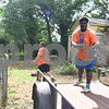 Kingdom Life Academy students Antione Neal, 18, Juan Uribe, 15, and Jaquan McKenzie, 17, help remove debris from trees from the yard of a home on Martin  Luther King Jr. Blvd. in Tyler Saturday morning June 11, 2016. The school has partnered with the City of Tyler to assist in yard work those who cannot do it themselves such as the elderly and disabled. <br /> <br /> (Sarah A. Miller/Tyler Morning Telegraph)